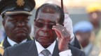 Zimbabwean President Robert Mugabe adjusts his glasses as he arrives to bid farewell and bury the late Cephas Msipa at the National Heroes Acre in Harare, Zimbabwe, 22 October 2016. (dpa / Aaron Ufumeli)